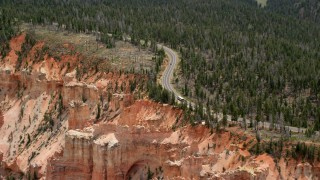 AX131_027 - 6K stock footage aerial video of Highway 63 and Pink Cliffs, Bryce Canyon National Park, Utah
