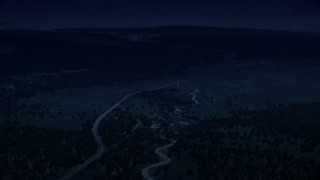 AX131_040_DFN - Aerial stock footage of 4K day for night color corrected aerial footage fly over dirt roads near forest, Grand Staircase-Escalante National Monument, Utah