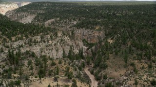 AX131_044 - 6K stock footage aerial video of approaching rocky canyon, Grand Staircase-Escalante National Monument, Utah