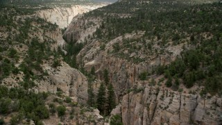 AX131_045 - 6K stock footage aerial video of flying over narrow canyon, Grand Staircase-Escalante National Monument, Utah