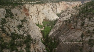 AX131_047 - 6K stock footage aerial video of flying through narrow canyon, Grand Staircase-Escalante National Monument, Utah