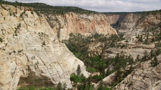 AX131_048 - 6K stock footage aerial video of flying through canyon, Grand Staircase-Escalante National Monument, Utah