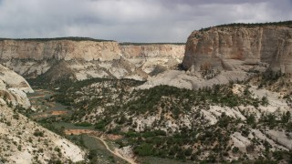 AX131_053 - 6K stock footage aerial video of flying low through canyon, Grand Staircase-Escalante National Monument, Utah