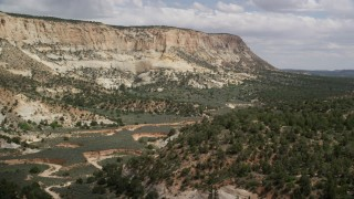 AX131_056 - 6K stock footage aerial video of flying low through canyon, Grand Staircase-Escalante National Monument, Utah