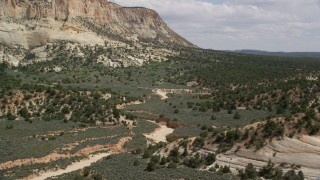 AX131_057 - 6K stock footage aerial video of flying over dry riverbed, Grand Staircase-Escalante National Monument, Utah