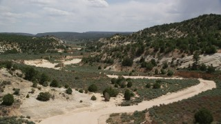 AX131_060 - 6K stock footage aerial video of a dry riverbed in the hills, Grand Staircase-Escalante National Monument, Utah