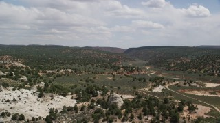 AX131_066 - 6K stock footage aerial video fly over hills and trees, Grand Staircase-Escalante National Monument, Utah