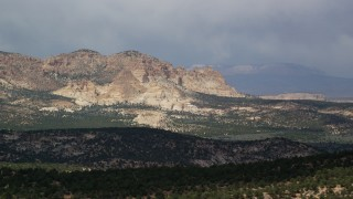 AX131_069 - 6K stock footage aerial video of flying by rugged mountains, Grand Staircase-Escalante National Monument, Utah