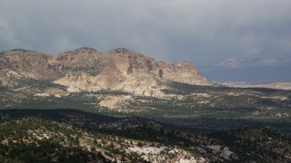 AX131_070 - 6K stock footage aerial video of passing by rugged mountains, Grand Staircase-Escalante National Monument, Utah
