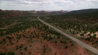 AX131_080 - 6K stock footage aerial video of approaching SUV on Highway 89 through Glen Canyon National Recreation Area, Utah, Arizona