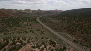 AX131_081 - 6K stock footage aerial video of following Highway 89 through Glen Canyon National Recreation Area, Utah, Arizona