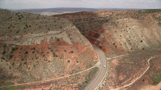 AX131_090 - 6K stock footage aerial video track a car on Highway 89, Glen Canyon National Recreation Area, Utah, Arizona
