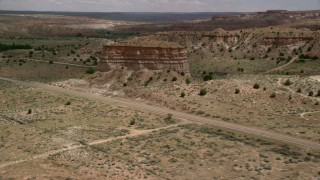AX131_098 - 6K stock footage aerial video of flying by butte beside Highway 89, Glen Canyon National Recreation Area, Utah, Arizona