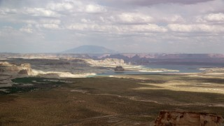 AX131_122 - 6K stock footage aerial video of passing Lone Rock and Lake Powell by Glen Canyon National Recreation Area, Utah, Arizona