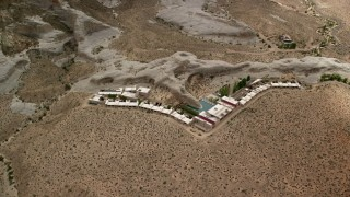 AX131_124 - 6K stock footage aerial video flyby the Amangiri Resort, Glen Canyon National Recreation Area, Utah, Arizona