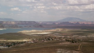 AX131_126 - 6K stock footage aerial video flyby Wahweap and Lake Powell, seen from Glen Canyon National Recreation Area, Utah, Arizona