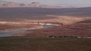AX131_130 - 6K stock footage aerial video of passing by Lake Powell and desert, Glen Canyon National Recreation Area, Utah, Arizona