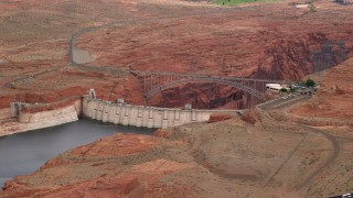 AX131_132 - 6K stock footage aerial video of the Glen Canyon Dam and Bridge, Arizona