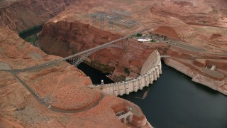 AX131_136 - 6K stock footage aerial video of orbiting the Glen Canyon Dam and Bridge, Arizona