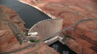 AX131_140 - 6K stock footage aerial video of circling the Glen Canyon Dam and Bridge, Arizona