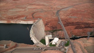 AX131_141 - 6K stock footage aerial video of circling above the Glen Canyon Dam and Bridge, Arizona
