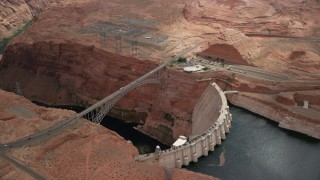 AX131_143 - 6K stock footage aerial video orbit above the Glen Canyon Dam and Bridge, Arizona