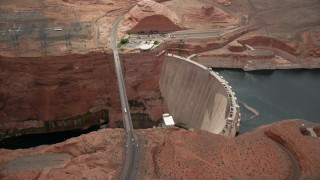 AX131_144 - 6K stock footage aerial video of flying away from the Glen Canyon Dam and Bridge, Arizona
