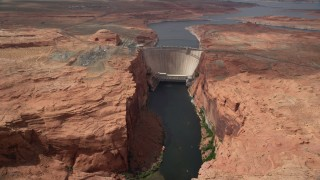 AX131_145 - 6K stock footage aerial video of following Colorado River, approaching the Glen Canyon Dam and Bridge, Arizona