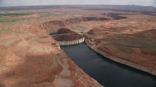 AX131_150 - 6K stock footage aerial video of an approach to Glen Canyon Dam and Glen Canyon Dam Bridge, Arizona