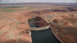 AX131_151 - 6K stock footage aerial video approach and tilt to Glen Canyon Dam, Glen Canyon Dam Bridge, Arizona