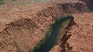AX131_154 - 6K stock footage aerial video panning across the Colorado River while flying over Glen Canyon, Arizona