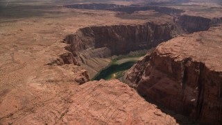 AX131_158 - 6K stock footage aerial video of flying toward the Colorado River at the bottom of Glen Canyon, Arizona