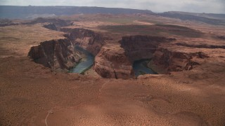 AX131_165 - 6K stock footage aerial video of approaching Horseshoe Bend, tilt to Colorado River, Glen Canyon, Arizona