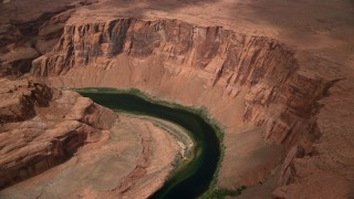 AX131_169 - 6K stock footage aerial video of orbiting Horseshoe Bend and the Colorado River, Glen Canyon, Arizona