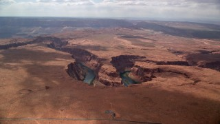 AX131_171 - 6K stock footage aerial video of a wide view of Horseshoe Bend and the Colorado River, Glen Canyon, Arizona