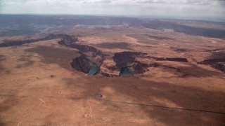AX131_173 - 6K stock footage aerial video of approaching Horseshoe Bend, and the Colorado River in Glen Canyon, Arizona