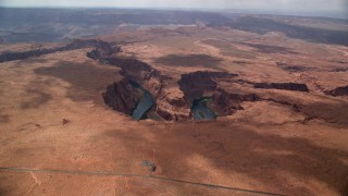 AX131_174 - 6K stock footage aerial video of an approach to Horseshoe Bend and the Colorado River, Glen Canyon, Arizona