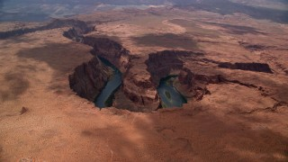 AX131_175 - 6K aerial stock footage video approach Horseshoe Bend, tilt to Colorado River, Glen Canyon, Arizona