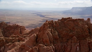 AX131_194 - 6K stock footage aerial video fly over peak to reveal Marble Canyon at Glen Canyon National Recreation Area, Utah, Arizona