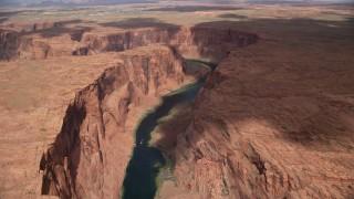 AX131_209 - 6K stock footage aerial video follow Colorado River, fly toward Horseshoe Bend, Glen Canyon, Arizona