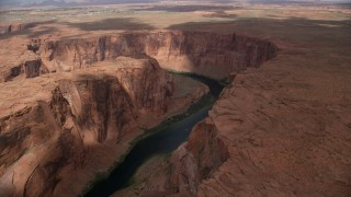 AX131_210 - 6K stock footage aerial video of flying over Colorado River, approaching Horseshoe Bend, Glen Canyon, Arizona