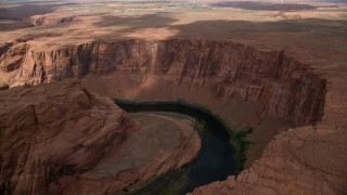 AX131_212 - 6K stock footage aerial video of flying by Horseshoe Bend, tilt to Colorado River, Glen Canyon, Arizona