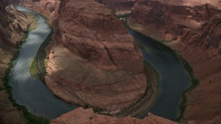 AX131_215 - 6K stock footage aerial video of orbiting canyon rim of Horseshoe Bend, view of Colorado River, Glen Canyon, Arizona