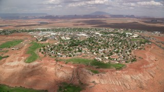 AX131_222 - 6K stock footage aerial video of approaching a small desert town, Page, Arizona