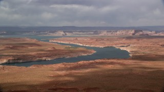 AX131_225 - 6K stock footage aerial video of Lake Powell and distant mesas, Utah, Arizona