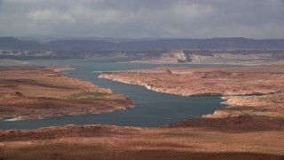 AX131_227 - 6K stock footage aerial video of passing Lake Powell, mesas in the background, Utah, Arizona