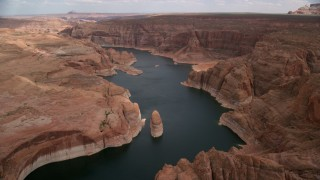AX131_229 - 6K stock footage aerial video of following Lake Powell past cliffs, rock formations, Navajo Canyon, Arizona