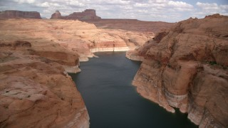 AX131_234 - 6K stock footage aerial video of Lake Powell in Navajo Canyon, Arizona