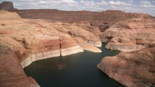 AX131_236 - 6K stock footage aerial video of flying over Lake Powell around a bend, Navajo Canyon, Arizona