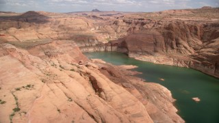 AX131_240 - 6K stock footage aerial video of flying over cliffs by Lake Powell, Navajo Canyon, Arizona